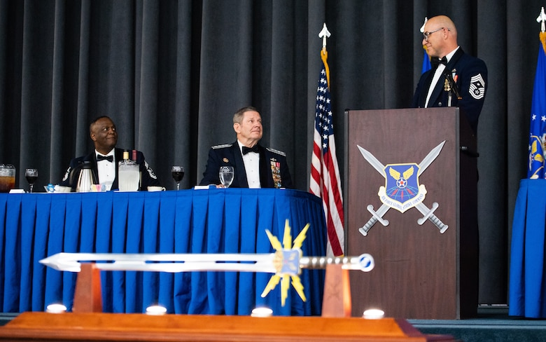 Retired Gen. Robin Rand, former Air Force Global Strike Command commander, is honored at an Order of the Sword ceremony at Barksdale Air Force Base, Louisiana, April 23, 2021. The Order of the Sword is a rare honor bestowed on a senior officer or civilian by the noncommissioned officers of a command to recognize individuals who have made significant contributions to the enlisted corps. (U.S. Air Force photo by Airman 1st Class Jacob B. Wrightsman)