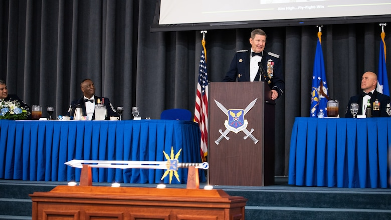 Retired Gen. Robin Rand, center, former Air Force Global Strike Command commander, makes remarks after being honored at an Order of the Sword ceremony at Barksdale Air Force Base, Louisiana, April 23, 2021. The Order of the Sword ceremony was patterned after two orders of chivalry founded during the Middle Ages in Europe: the (British) Royal Order of the Sword and the Swedish Military Order of the Sword, still in existence today. (U.S. Air Force photo by Airman 1st Class Jacob B. Wrightsman)