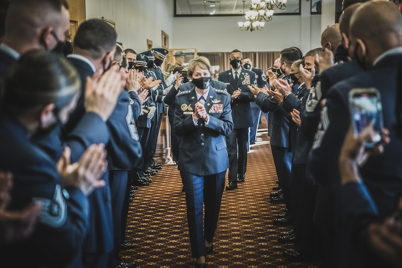 U.S. Air Force Gen., retired, Maryanne Miller, is welcomed by a room of applause as she arrives at the Air Mobility Command's Order of the Sword ceremony in her honor at Joint Base McGuire-Dix-Lakehurst, N.J, April 23, 2021.
