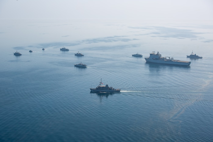 210421-A-BD272-0359 ARABIAN GULF (April 21, 2021) - A multinational group of mine countermeasure ships from the French Marine Nationale, UK Royal Navy and U.S. Navy operate in formation during exercise Artemis Trident 21 in the Arabian Gulf, April 21. Artemis Trident 21 is a multilateral mine countermeasures exercise between the UK, Australia, France and U.S., designed to enhance mutual interoperability and capabilities in mine hunting and clearance, maritime security and dive operations, allowing participating naval forces to effectively develop the necessary skills to address threats to regional security, freedom of navigation and the free flow of commerce. (U.S. Army photo by Spc. Theoren Neal)