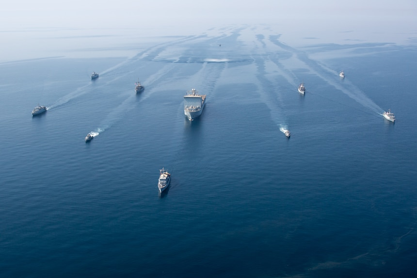 "A multinational group of mine countermeasure ships from the French Marine Nationale, UK Royal Navy, U.S. Navy and a MH-53E Sea Dragon helicopter, attached to the ""Blackhawks"" of Helicopter Mine Countermeasures Squadron (HM-15), operate in formation during exercise Artemis Trident 21 in the Arabian Gulf."