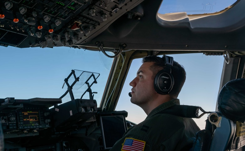 Capt. Stephen Tice, 3rd Airlift Squadron pilot, flies a C-17 Globemaster III during a local training flight over Ohio, April 22, 2021. The 3rd AS trains to support global engagement through direct delivery of critical theater assets and to ensure combat readiness of Air Mobility Command C-17 aircrews. (U.S. Air Force photo by Airman 1st Class Faith Schaefer)