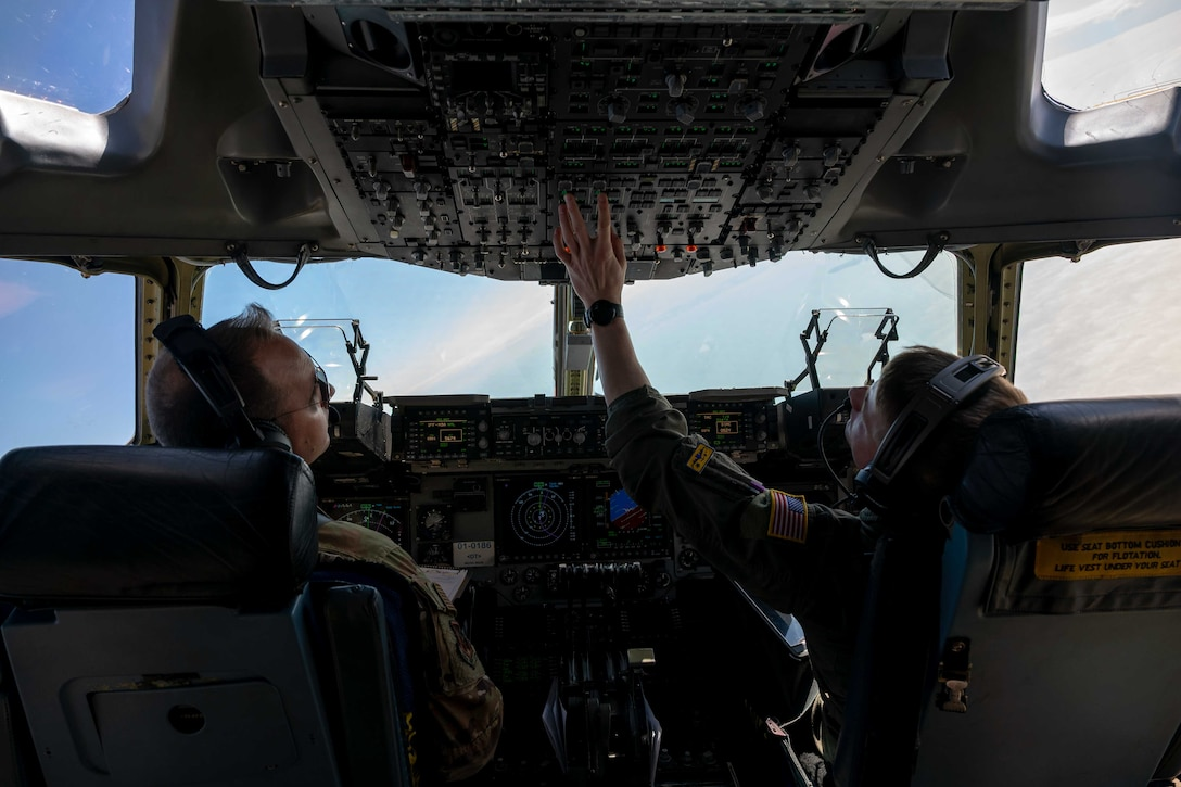 From the left, Maj. James Johnson and 1st Lt. Forrest Doss, both 3rd Airlift Squadron pilots, fly a C-17 Globemaster III during a local training flight over Ohio, April 22, 2021. The 3rd AS trains to support global engagement through direct delivery of critical theater assets and to ensure combat readiness of Air Mobility Command C-17 aircrews. (U.S. Air Force photo by Airman 1st Class Faith Schaefer)