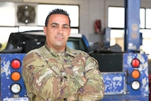 U.S. Air Force Staff Sgt. David Ramirez, heavy mobile equipment mechanic, 156th Logistics Readiness Squadron, poses for a picture at Muñiz Air National Guard Base, Puerto Rico Air National Guard, April 20, 2021. (U.S. Air National Guard photo by Staff Sgt. Eliezer Soto)