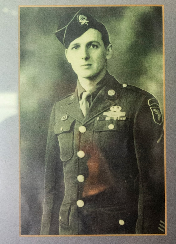 "A photo of then Private Jim ""Pee Wee"" Martin, hangs on the wall inside his Xenia, Ohio, home, April 15, 2021. Martin served as a paratrooper assigned to 101st Airborne Division, 506th Infantry Regiment, G Company, out of Fort Campbell, Kentucky. (U.S. Air Force photo by Wesley Farnsworth)"