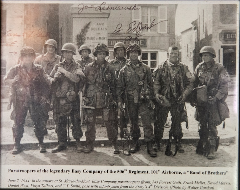 "A photo of WWII veteran Jim ""Pee Wee"" Martin and some of his unit's members, hangs on the wall inside his Xenia, Ohio, home, April 15, 2021. Martin served as a paratrooper assigned to 101st Airborne Division, 506th Infantry Regiment, G Company, out of Fort Campbell, Kentucky. (U.S. Air Force photo by Wesley Farnsworth)"