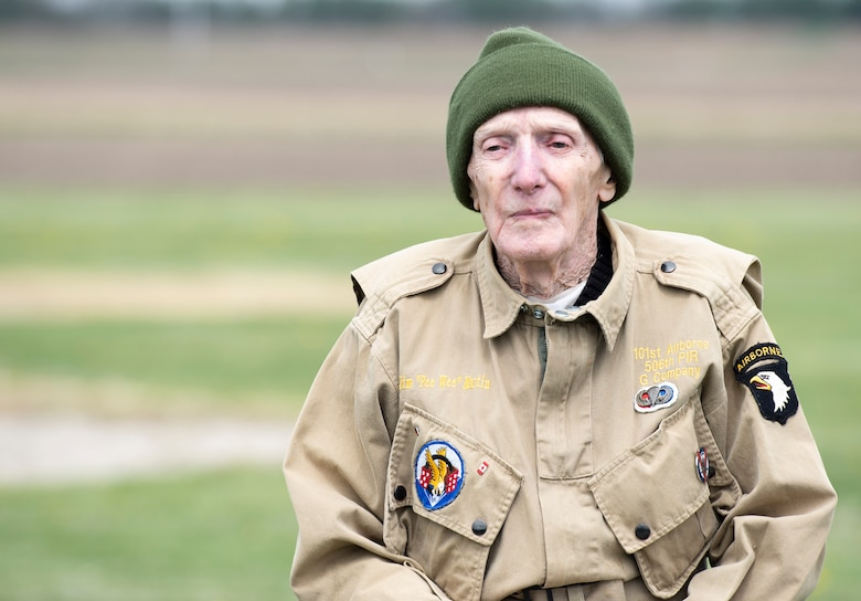 "WWII veteran Jim ""Pee Wee"" Martin, poses for a photo during a 100th birthday celebration held in his honor April 23, 2021, in Xenia, Ohio. Martin served as a paratrooper assigned to 101st Airborne Division, 506th Infantry Regiment, G Company, out of Fort Campbell, Kentucky. (U.S. Air Force photo by Wesley Farnsworth)"