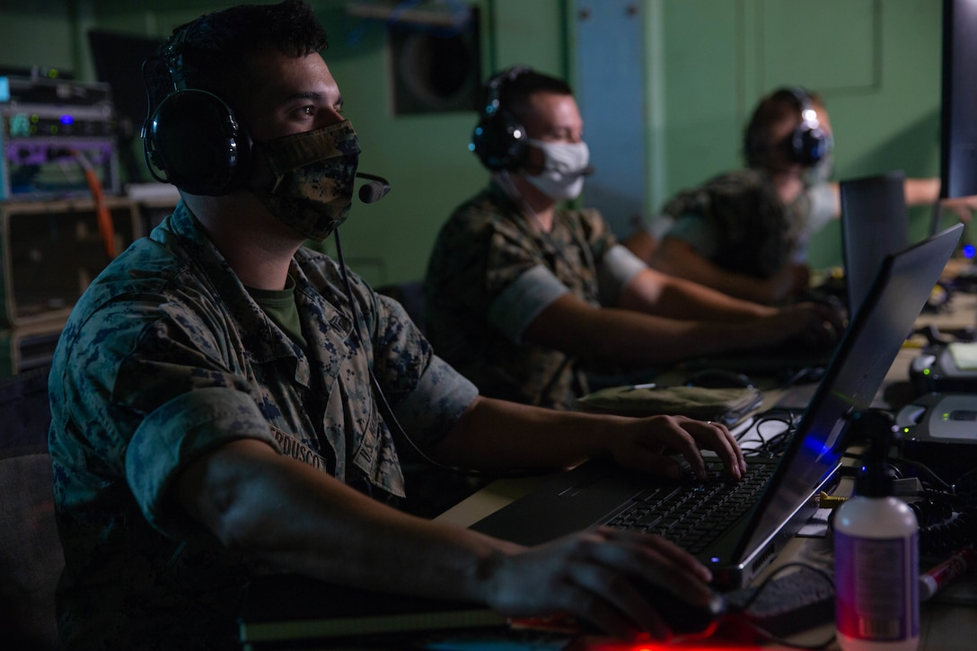 U.S. Marines monitor simulated aircraft communications at Marine Corps Air Station Cherry Point, N.C., July 28.
