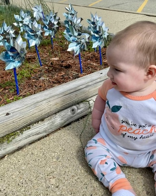 Georgia Rupert looks at the Pinwheel Garden planted in front of New Horizons Child Development Center on Wright- Patterson Air Force Base, Ohio April 23, 2021. Pinwheels for Prevention is a national campaign that's goal is to bring awareness to child abuse.