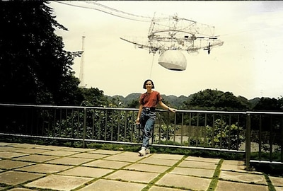 Lymari standing at the Arecibo Radio Telescope