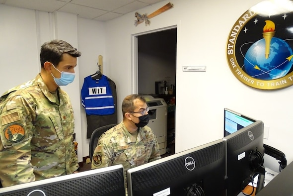 Photo of airmen training at a computer station