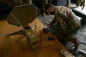 Airmen set up a mobile command post