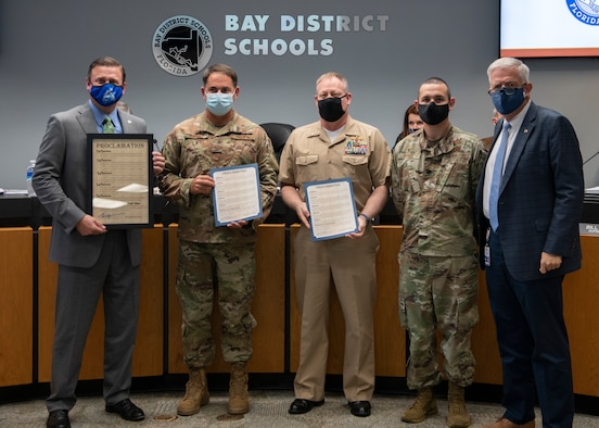 Leadership from Tyndall Air Force Base and Naval Support Activity Panama City signed an annual proclamation with the Bay District school board, designating April as Month of the Military Child.