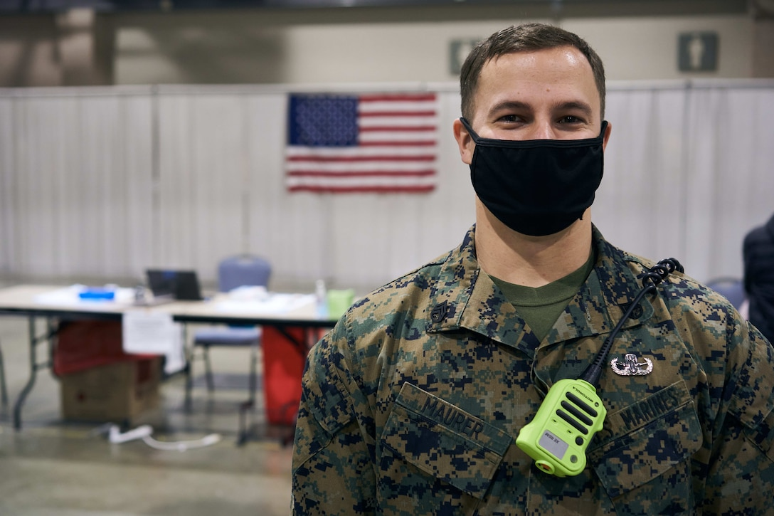 A U.S. Marine poses for a portrait at the state-run, federally-supported Community Vaccination Center at the Pennsylvania Convention Center in Philadelphia, Pa., April 27.