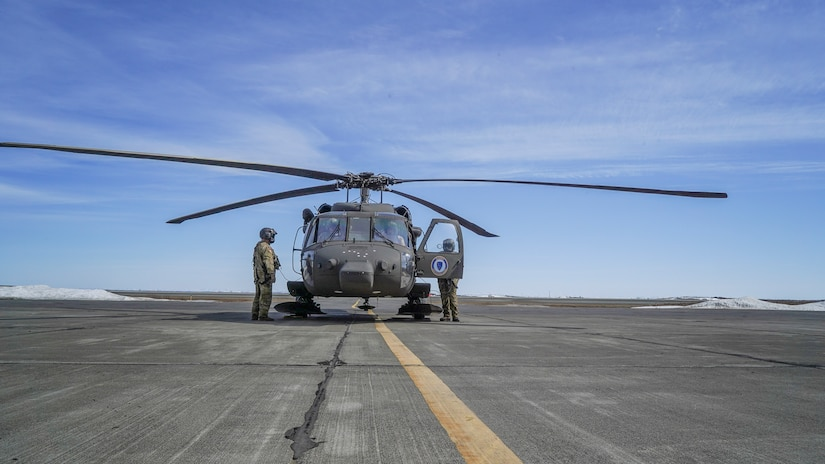 A hoist-capable UH-60 Black Hawk helicopter and aircrew from the 1st Battalion, 207th Aviation Regiment, Alaska Army National Guard, arrives in Bethel, Alaska, April 27, 2021, as part of the State of Alaska's effort to prepare for disaster response in the Yukon-Kuskokwim region during the spring flood season. While stationed in Bethel, the crew will continue to train on their federal mission and remain ready to respond to any requests for support from civil authorities through the State Emergency Operations Center.