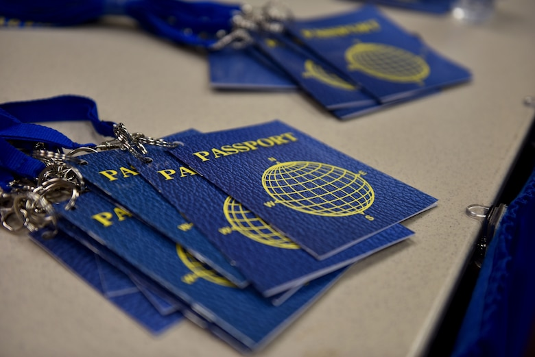 Passports line a table at the Around the World International Cultural Fair at Angelo State University in San Angelo, Texas, April 29, 2021. The passports were used by students as they toured booths displaying different items from various cultures. (U.S. Air Force photo by Staff Sgt. Seraiah Wolf)