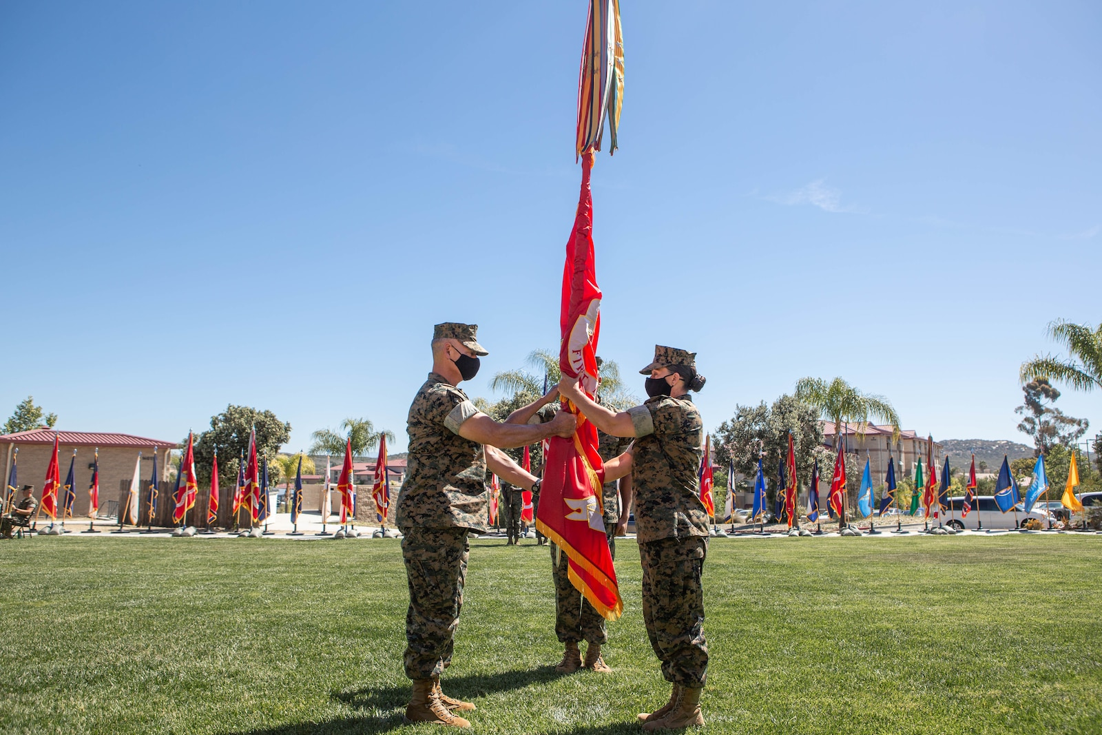 U.S. Marine Corps Brig. Gen. Bobbi Shea, U.S. Marine Corps Brig. Gen. Bobbi Shea, exchange the Group colors during the 1st Marine Logistics Group change of command ceremony.