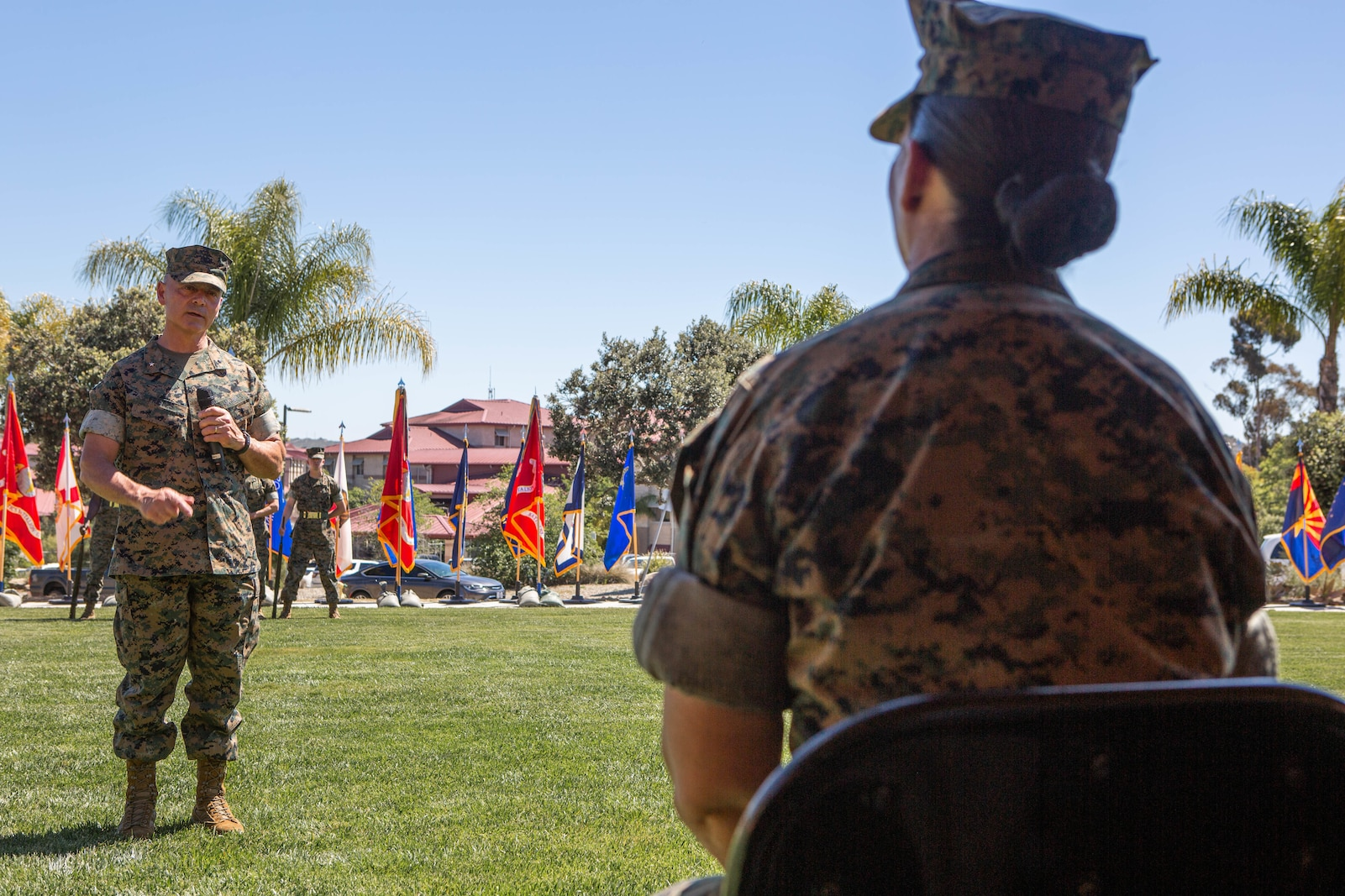 U.S. Marine Corps Brig. Gen. Bobbi Shea, outgoing Commanding General, gives remarks during the 1st Marine Logistics Group change of command ceremony.