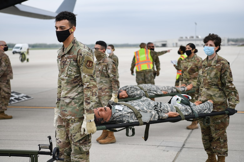 """Medical personnel from Wright-Patterson Air Force Base, Ohio transport """"patients"""" during the annual Exercise Ultimate Caduceus April 28, 2021."""