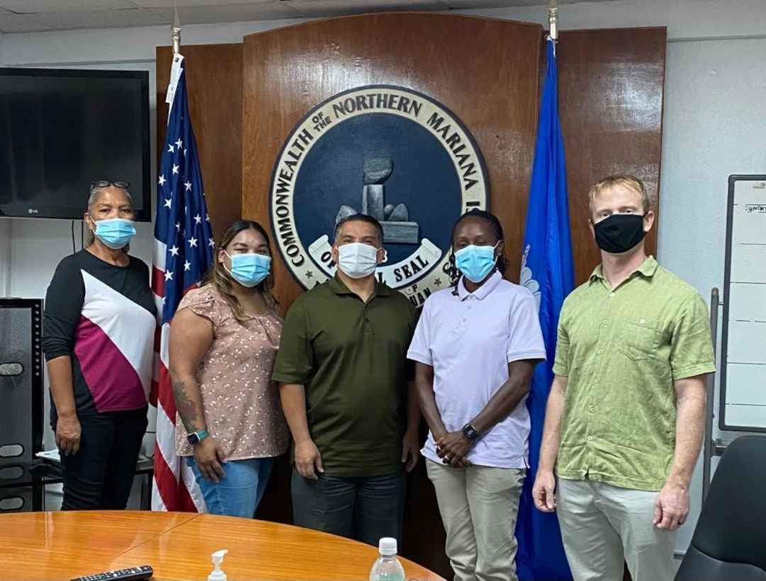 Andersen Air Force Base Office of Special Investigations agents and Tinian government officials pose for a photo during a meet and greet at Tinian, April 7, 2021. OSI Agents traveled throughout the Commonwealth Northern Mariana Islands to build relationships with law enforcement and security counterparts.