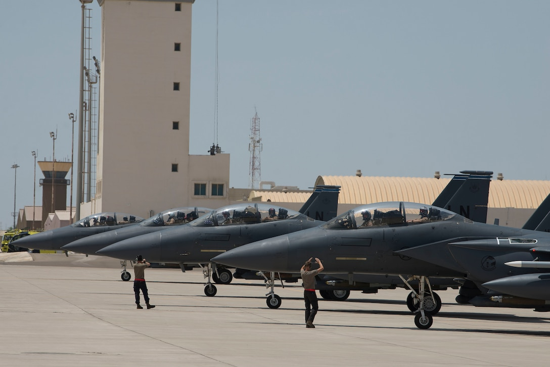 Four F-15E Strike Eagles assigned to the 494th Expeditionary Fighter Squadron (EFS) line up on the flightline at Al Dhafra Air Base, United Arab Emirates, April 25, 2021. Pilots and maintainers assigned to the 494th EFS, 332nd Air Expeditionary Wing executed the first combat tactical ferry mission as part of an Agile Combat Employment operation in a deployed theater. (U.S. Air Force photo by Staff Sgt. Zade Vadnais)