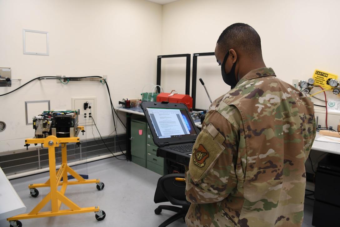 A precision measurement equipment laboratory technician from the 18th Component Maintenance Squadron calibrates a piece of equipment.
