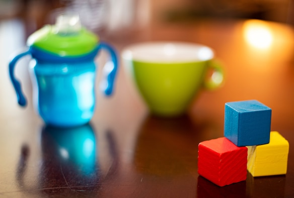 blocks in front of two cups
