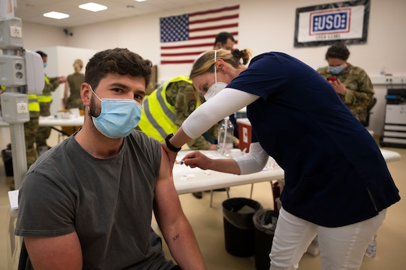 Benny Klein, 86th Civil Engineer Group accounting technician, receives a COVID-19 vaccine shot from Iris Geist, a German local national nurse, at Ramstein Air Base, Germany