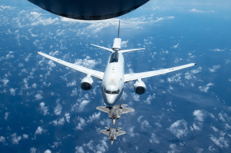 A Royal Australian Air Force E-7A Wedgetail, operated by No. 2 Squadron based at RAAF Base Williamtown, Australia, flies in formation with Hawaii Air National Guard F-22 Raptors April 21, 2021, near Oahu, Hawaii, as part of the Pacific Edge 21 exercise.
