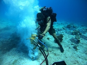 UTC-2 work on a mooring anchor during Project Big Wave.