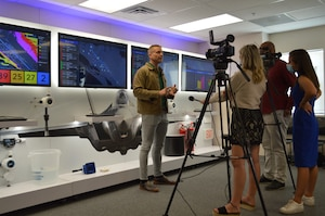 Lowell Usrey, Tyndall's PMO Integration branch chief, tells local media about the innovative capabilities the Installation Resilience Operations Center will bring to Tyndall Air Force Base, Florida, April 28, 2021. (U.S. Air Force photo by Sarah McNair)