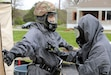U.S. Army Reserve Spc. Bishal Kim (right)  checks Spc. Mark Mikhail for radiation (right), as part of the decontamination process during a situational training lane at Muscatatuck Urban Training Center, Ind., April 21, 2021. The two Soldiers are both chemical, biological, radiological, and nuclear specialists of the 307th Chemical Company out of Bell, Calif., and are participating in Guardian Response, a homeland emergency response exercise commanded by the 78th Training Division that provides simulate disaster response training to sharpen the skills and increase the capabilities of U.S. Army Reserve Soldiers (Photo by Sgt. William J. Taylor, 314th Theater Public Affairs Support Element).