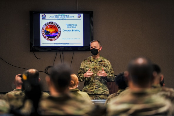 U.S. Air Force Col. Paul M. Skipworth, wing commander of the 446th Airlift Wing, provides opening remarks to wing Reserve Citizen Airmen participating in exercise NEXUS DAWN April 25, 2021 at Joint Base Lewis-McChord, Washington, before they depart for March Air Reserve Base, California.