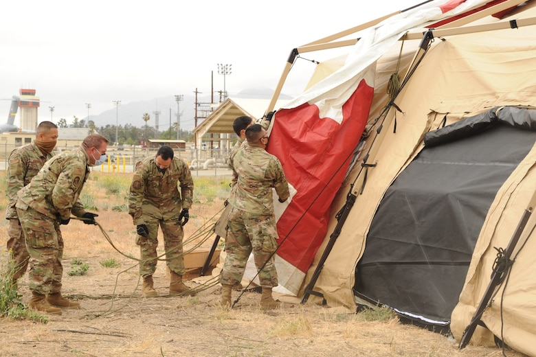 Reserve Citizen Airmen set up an expeditionary medical support system (EMEDS), a field hospital, in support of Exercise NEXUS DAWN at March Air Reserve Base, California, April 26, 2021.