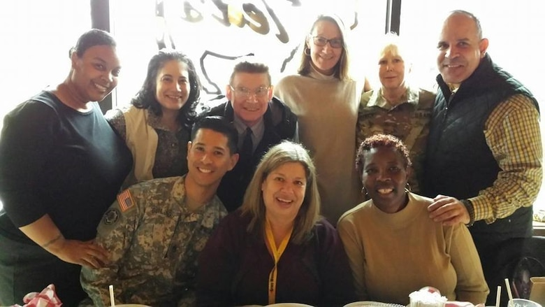 Ms. Vicki Mullen poses for a photo alongside her then coworkers at the U.S. Army's Recovery Care Program in Alexandria, Va., Jan. 1.