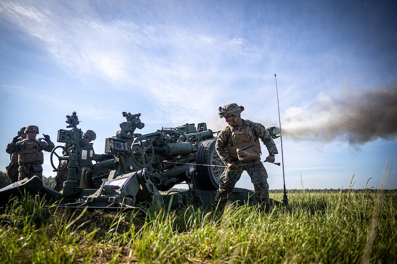 U.S. Marines with 2d Battalion, 10th Marine Regiment, 2d Marine Division, fire a M777 Howitzer in support of an artillery raid as part of Exercise Rolling Thunder 21.2 at Camp Lejeune, N.C., April 28, 2021. This exercise is a 10th Marine Regiment-led live-fire artillery event that tests 10th Marines' abilities to operate in a simulated littoral environment against a peer threat in a dynamic and multi-domain scenario. (U.S. Marine Corps photo by Lance Cpl. Brian Bolin Jr.)