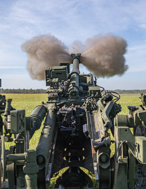 U.S. Marines with 2d Battalion, 10th Marine Regiment, 2d Marine Division, fire a M777 Howitzer during an artillery raid as part of Exercise Rolling Thunder 21.2 at Camp Lejeune, N.C., April 28, 2021. This exercise is a 10th Marine Regiment-led live-fire artillery event that tests 10th Marines' abilities to operate in a simulated littoral environment against a peer threat in a dynamic and multi-domain scenario. (U.S. Marine Corps photo by Lance Cpl. Brian Bolin Jr.)