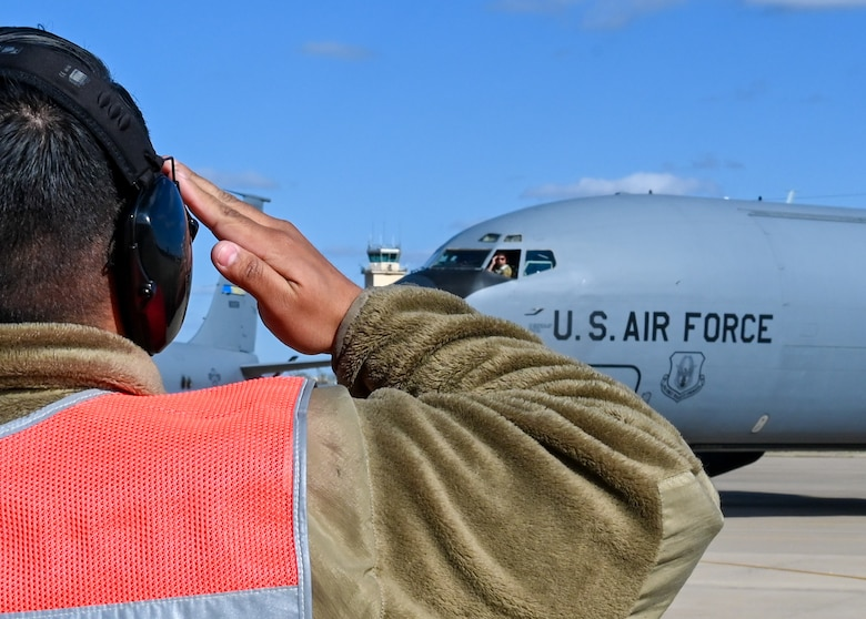 A crew chief from the 507th Aircraft Maintenance Squadron marshals a KC-135R Stratotanker April 7, 2021, at Tinker Air Force Base, Oklahoma. (U.S. Air Force photo by Senior Airman Mary Begy)