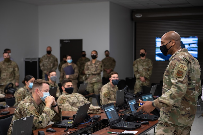 Photo of Air Force leadership talking to Airmen