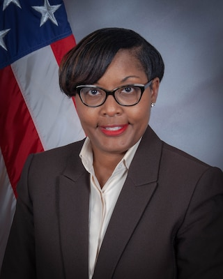 Dr. Angela Curtis, Deputy Director, DLA EEO portrait in front of a U.S. flag