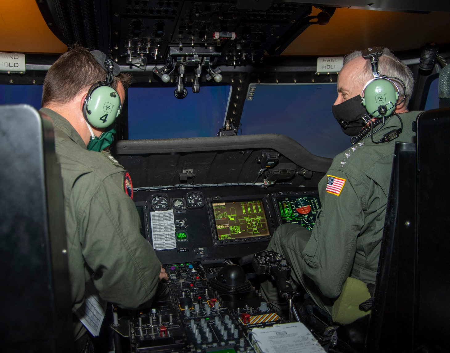 "Vice Chief of Naval Operations (VCNO), Adm. Bill Lescher, right, participates in a tactical operational flight training simulation with Lt. Zach Roecker, a Weapons and Tactics instructor assigned to the ""Seahawks"" of Helicopter Maritime Strike Squadron (HSM) 41."