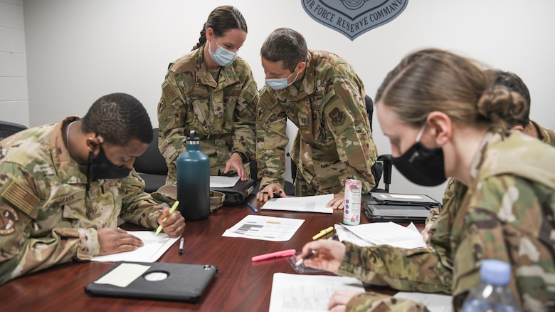 Reserve Citizen Airmen from the 445th Aeromedical Evacuation Squadron brief before a flight during the Ultimate Caduceus training exercise April 30, 2021.  U.S. Transportation Command (USTRANSCOM) began a week-long aeromedical and global patient movement exercise, Ultimate Caduceus, April 26. Approximately 250 personnel including members of the 445th Airlift Wing and the 88th Air Base Wing participated in the field training exercise. (U.S. Air Force photo//Master Sgt. Patrick O'Reilly)