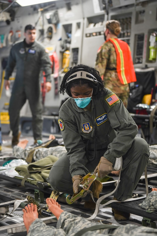 Senior Shirneal Burnside, 445th Aeromedical Evacuation Squadron, secures the litter of patients on a 445th Airlift Wing C-17 Globemaster III during the Ultimate Caduceus training exercise April 29, 2021. U.S. Transportation Command (USTRANSCOM) began a week-long aeromedical and global patient movement exercise, Ultimate Caduceus, April 26. Approximately 250 personnel including members of the 445th Airlift Wing and the 88th Air Base Wing participated in the field training exercise. (U.S. Air Force photo//Master Sgt. Patrick O'Reilly)