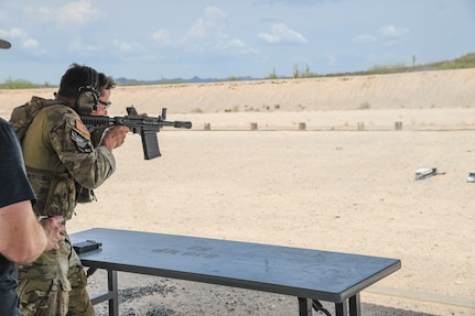 A staff sergeant (name withheld for security) from the 19th Special Forces Group (Airborne) competes in the three-gun challenge event July 20, 2021, during the U.S. Army National Guard Best Warrior Competition at Florence Military Reservation, Arizona.
