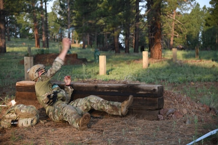 A staff sergeant (name withheld for security) from the 19th Special Forces Group (Airborne) competes in the grenade lanes July 21, 2021, during the U.S. Army National Guard Best Warrior Competition at Camp Navajo Military Reservation, Arizona.
