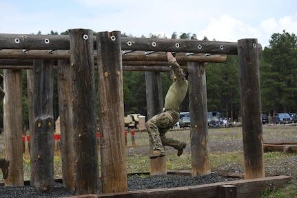 A staff sergeant (name withheld for security) from the 19th Special Forces Group (Airborne) navigates the obstacle course during the U.S. Army National Guard Best Warrior Competition at Camp Navajo Military Reservation, Arizona July 21, 2021.