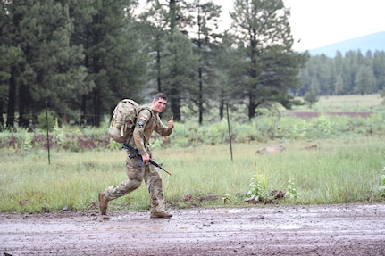 Spc. Adam Barlow, from the 65th Field Artillery Brigade, Utah National Guard, competes in the16-mile, ruck-march event July 22, 2021, during the U.S. Army National Guard Best Warrior Competition at Camp Navajo Military Reservation, Arizona.