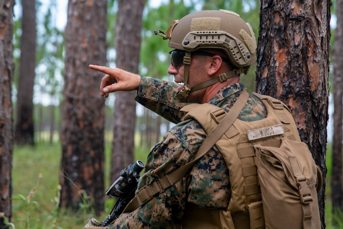 U.S. Marine Corps Lance Cpl. Nathan Wood, a native of Savannah, Ga., and a rifleman with 2d Battalion, 6th Marine Regiment, 2d Marine Division, directs Marines during a range as part of a Marine Corps Combat Readiness Evaluation (MCCRE) at Camp Lejeune, N.C., July 27, 2021. A MCCRE is an exercise designed to formally evaluate a unit's combat readiness and if successful, the unit will achieve apex status and is deemed ready for global employment. (U.S. Marine Corps photo by Pfc. Sarah Pysher)
