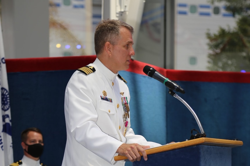 210730-N-YR423-0003 PENSACOLA, Fla. (July 30, 2021) Outgoing Naval Education and Training Professional Development Center (NETPDC) Commanding Officer Capt. Brett St. George addresses the crowd during a change of command ceremony held at the National Aviation Museum onboard Naval Air Station Pensacola, July 30, 2021. St. George, who retired during the ceremony after 24 years of service, thanked the crowd for their many contributions to the many command successes and accomplishments during his final tour. (U.S. Navy photo by Cheryl Dengler)