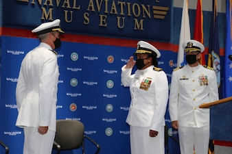 210730-N-YR423-0001 PENSACOLA, Fla. (July 30, 2021) Capt. Willie Brisbane (center) relieves Capt. Brett St. George (right) as commanding officer of Naval Education and Training Professional Development Center (NETPDC) during a ceremony held at the National Aviation Museum onboard Naval Air Station Pensacola, July 30, 2021. Brisbane takes the helm as NETPDC's 21st commanding officer. (U.S. Navy photo by Cheryl Dengler)